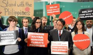 The Philippines' head negotiator Naderev Sano (2dR) and supporters hold banners while attending the United Nations Climate Change Conference COP 19 on November 19, 2013 in Warsaw. (JANEK SKARZYNSKI/AFP/Getty)